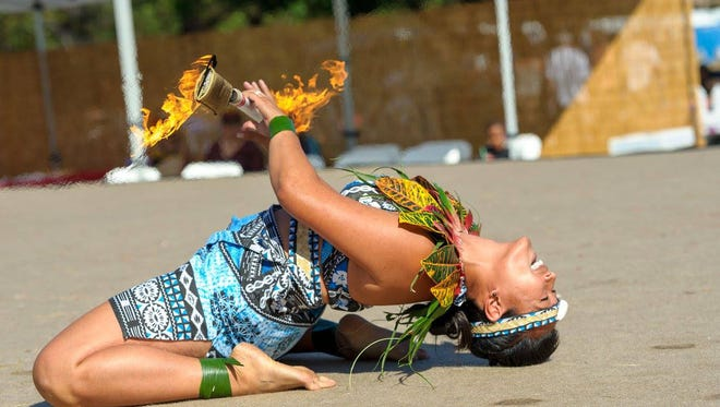 A member of the Island Fire Fitness group performs at the Pacific Islander Festival in San Diego on Sept. 24