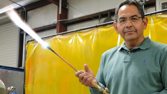 Gas business analyst Mario Puentes tests an acetylene torch in the Gas Training Center at Las Cruces Utilities.