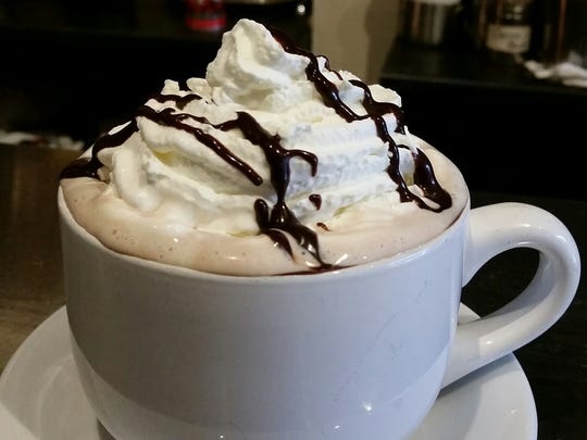 Hot chocolate with whipped cream from Jembetat Gallery & Cafe.