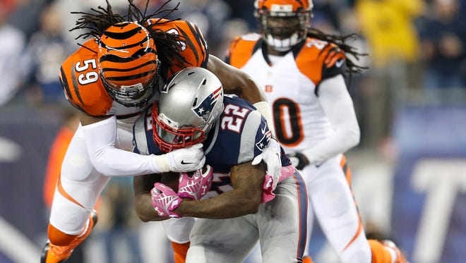 Bengals outside linebacker Emmanuel Lamur makes a tackle against the Patriots on Oct. 5.
