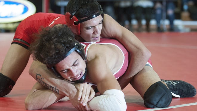 Delsea's Edison Echevarria, top, controls Paulsboro's Jacob Perez in a 120-pound bout on Jan. 20, a 36-22 Red Raiders' win. Both clubs are favorites to win South Jersey titles this postseason.