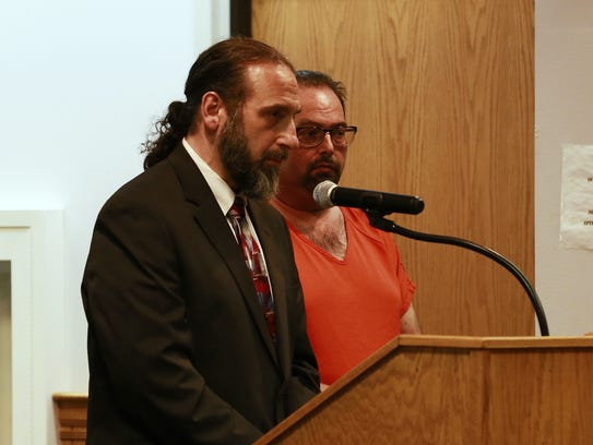 Robert Glazner, right, makes his initial appearance