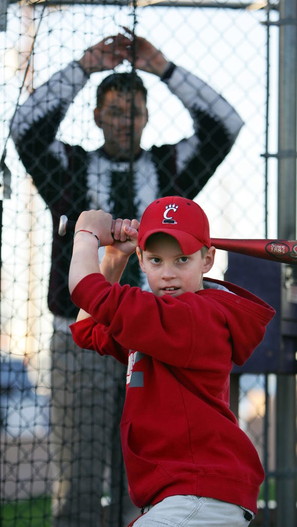 Homerun05 129513 : Mark Moran watches his son Spencer 9, take some cuts at Home Run Stadium Wednesday, Nov. 30, 2005. The batting cages have been a part of Mesa for 20 years. (cq names) (David Kadlubowski The Arizona Republic)