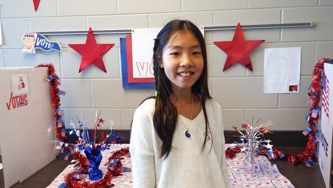 Fourth-grader Hahyeon Kim, 10, cast her vote for president at Borlaug Elementary in Coralville on Nov. 8, 2016.