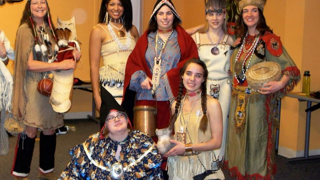 """Behind the scenes at """"Always in Fashion: 11,000 years of Wabanaki Clothing."""" Abenaki women model traditional clothing spanning thousands of years at the Vermont Indigenous Celebration during the Champlain Quadricentennial at ECHO Lake Aquarium in 2009."""