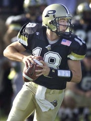 Kyle Orton drops back to pass for Purdue in the second