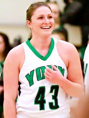 York College's Katie Wagner, center, reacts as she