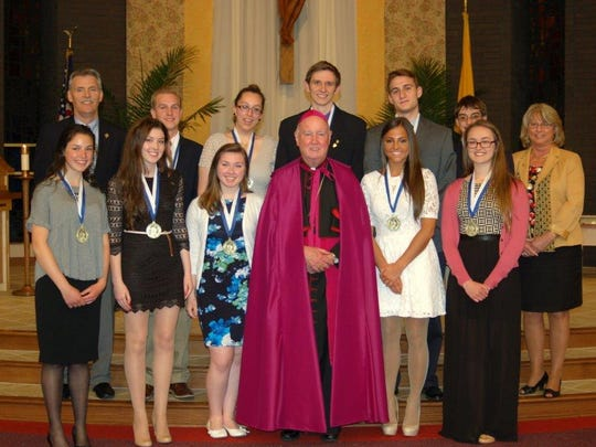 On April 30, the Diocese of Wilmington honored seniors Christina Danberg, Claire Danberg, Camilla Daniel, Carl DiStefano, Luke Duchemin, Hannah Falchuk, William Fay, Lauren Johnson, John Livingstone and Claudia Seemans with the St. Francis de Sales Award. The convocation was presided by Bishop Malooly at Holy Family Church.