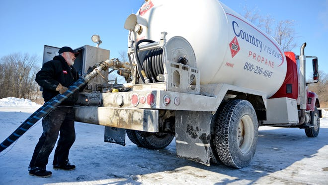 Jerry Petasek refills his propane delivery truck at the Country Visions Cooperative facility in De Pere last January.