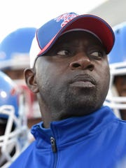 Noxubee County head coach Tyrone Shorter watches the