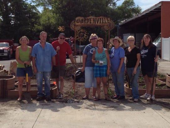 Planting Gardenville were Debbie Grochowski (from