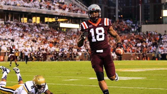 Virginia Tech Hokies wide receiver D.J. Coles (18) scores a touchdown in the first half against the Georgia Tech Yellow Jackets at Bobby Dodd Stadium.