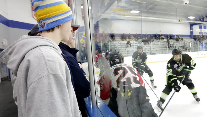 Riley Macinnis of St. Louis, Missouri watches a hockey game before his team plays Friday March 17, 2017 at the Blue Line Family Ice Center in Fond du Lac. The Blue Line hosted a 17 team tournament bringing players and revenue from around the midwest to Fond du Lac over the weekend.