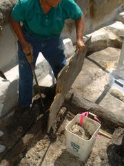 Judy Bense, the University of West Florida's director of archaeology, works in the field at a unique find in downtown Pensacola on July 31, 2005.