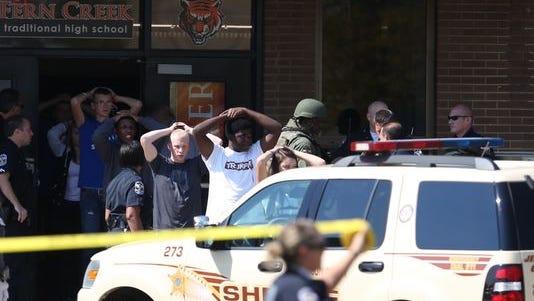 Fern Creek High School students being evacuated after confirmed shooting.