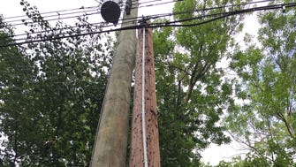 One of the white PVC pipes installed on a utility pole in Mahwah that officials say are prohibited because they constitute a sign.
