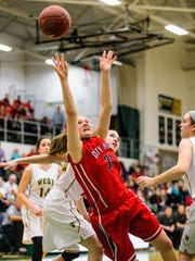 Iowa City High's Courtney Joens (31) puts up a falling layup against Iowa City West during the first half of play at Iowa City West High on Friday, February 13, 2015. (Justin Torner/Freelance for the Press-Citizen)