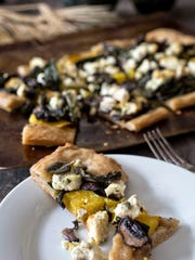 Fall pizza with acorn squash, broccoli rabe, kale, mushrooms, sage, brown butter, sage on sourdough crust.