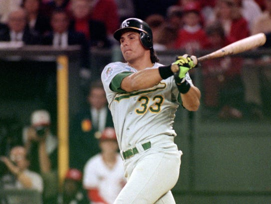 Jose Canseco of the Oakland Athletics watches the
