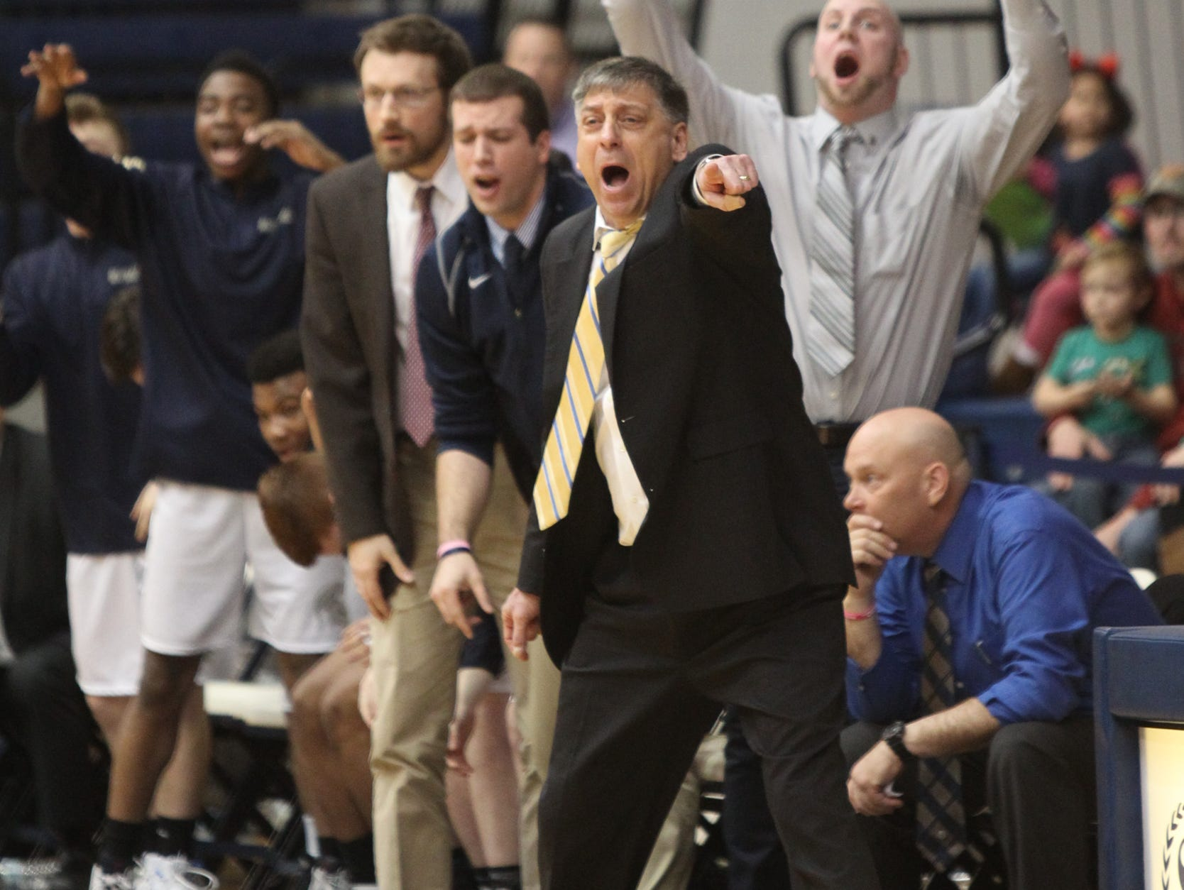 Our Lady of Lourdes boys basketball coach Jim Santoro calls out to his team during its victory over Poughkeepsie on Saturday at Pace University in Pleasantville.
