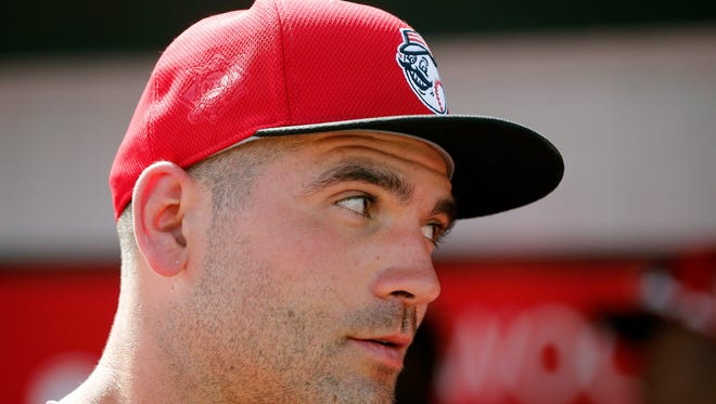 Cincinnati Reds first baseman Joey Votto (19) talks with announcer Jim Day during an interview during the bottom of the third inning of the MLB Spring Training game between the Cleveland Indians and the Cincinnati Reds at Goodyear Ballpark in Goodyear, Ariz., on Wednesday, March 2, 2016. The Reds and Indians tied, 4-4.