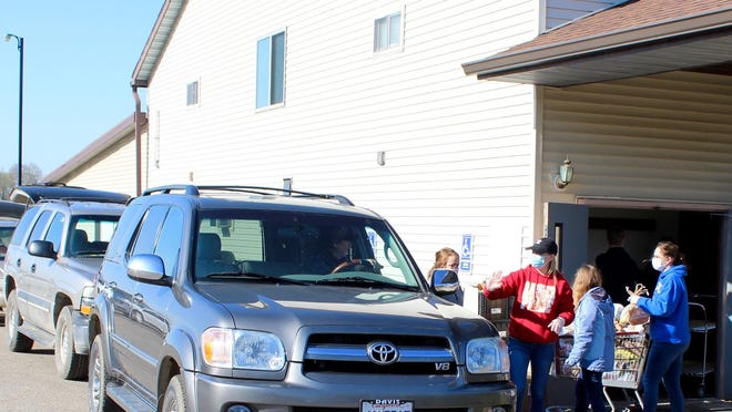 Volunteers work to fill cars during a Hillsdale Baptist Church Food Pantry drive-through.