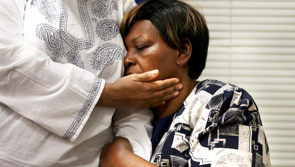 Audrey DuBose is comforted by her daughter, Terina