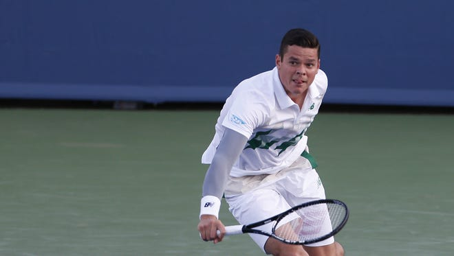 Milos Raonic (CAN) returns a backhand to Robby Ginepri (USA) during their match played at the Western & Southern Open held at the Lindner Family Tennis Center in Mason, Ohio Wednesday August 13, 2014.
