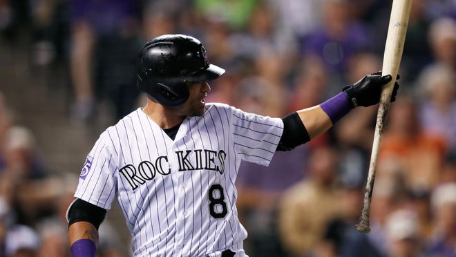 Colorado Rockies pinch-hitter Gerardo Parra waves his bat at third base umpire Chris Guccione, who had ruled Parra went around on a check swing to strike out to San Francisco Giants relief pitcher Reyes Moronta during the seventh inning of a baseball game Tuesday, Sept. 4, 2018, in Denver. (AP Photo/David Zalubowski)