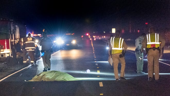 Officers from the CHP and Tulare County Sheriff Department investigate a hit and run fatality on Highway 137 between Roads 56 and 60 on Tuesday, March 6, 2018.