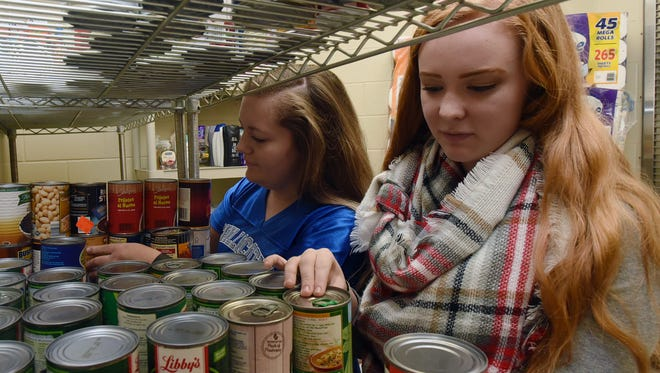 Reagan Taylor, left, and Maggie McCorkle organize the canned foods for the Cavalier Closet on Friday at Chillicothe High School. The Cavalier Closet receives food, personal hygiene products, dish soap and other items to give to students in need.