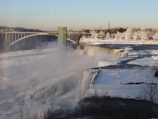 The area surrounding Niagara Falls, the international border between the U.S. and Canada in New York, is coated in a layer of ice.