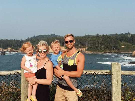 Tyler Braun, a pastor in Salem, poses with his wife and kids for a photo.