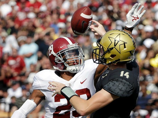 FILE - In this Saturday, Sept. 23, 2017, file photo, Alabama defensive back Minkah Fitzpatrick (29) hits the arm of Vanderbilt quarterback Kyle Shurmur (14) to cause an incomplete pass in the first half of an NCAA college football game in Nashville, Tenn. Goal-oriented since he was 6 and matured beyond his years by a disaster that left his family homeless as he started high school in New Jersey, Fitzpatrick has mastered Nick Saban's process. He sees the game like his coach, leads by example and has become maybe the most versatile defensive player to ever play for Saban. (AP Photo/Mark Humphrey, File)