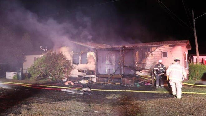 This mobile home at 10 Fernald Lane in Rochester was destroyed by a one-alarm fire Wednesday night. The fire displaced two people as well as sent one firefighter to the hospital for precautionary reasons due to a potential eye injury, according to fire officials.