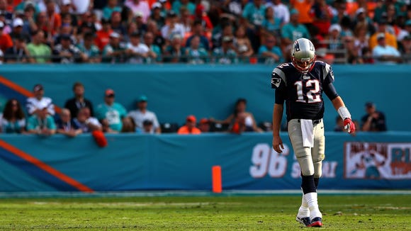 New England Patriots quarterback Tom Brady reacts to a play during Sunday's loss at Miami.