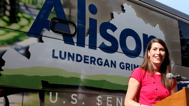 Alison Lundergan Grimes speaks in front of her campaign tour bus, which has become an issue in recent days.   Aaron Borton/Special to the Courier-Journal Alison Lundergan Grimes speaks to supporters at a rally in Shelbyville on Monday afternoon. May 19, 2014