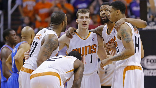 The Phoenix Suns huddle up late in the second half of their NBA game against the Oklahoma City Thunder on Sunday, April 6, 2014 in Phoenix.
