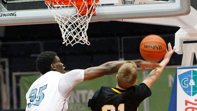Former Bishop Kearney star Chinonso Obokoh, left, attempts to block a shot in the Section V Class AA championship game on March 6, 2013. Obokoh is a redshirt freshman for Syracuse University.
