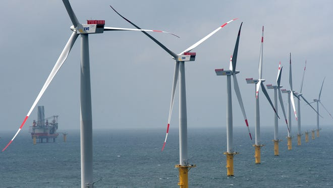 Wind turbines stand at an offshore wind farm in the North Sea on June 23, 2013, near Borkum, Germany. The facility includes 30 turbines with a capacity of 3.6 megawatts each for a total output of 108 megawatts, enough to provide power 120,000 households.