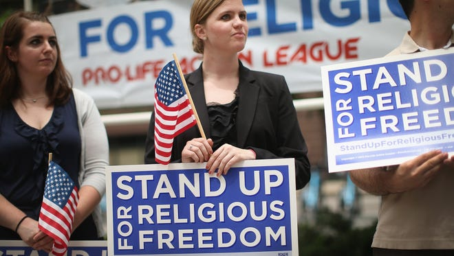 Religious freedom supporters hold a rally in Chicago on June 30, 2014, to praise the Supreme Court's decision in the Hobby Lobby, contraception coverage requirement case. Oklahoma-based Hobby Lobby, which operates a chain of arts-and-craft stores, challenged the provision and the high court ruled 5-4 that requiring family-owned corporations to pay for insurance coverage for contraception under the Affordable Care Act violated a federal law protecting religious freedom.