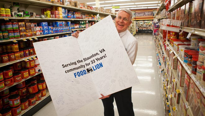 """Daniel Pritchett, who currently serves as the manager at Food Lion off of North Coalter Street, holds a retirement card signaling an end to his 48 year career working in the grocery store business. His """"bittersweet"""" last day will be May 1."""