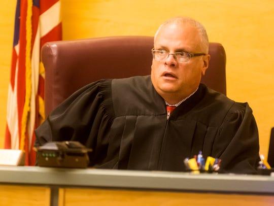 Judge Cristen P. D'Arrigo questions Jeremiah E. Monell,