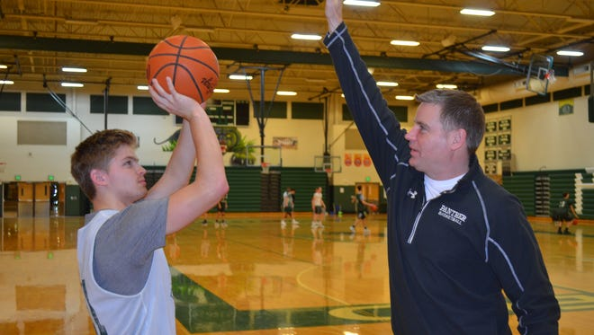 Pennfield senior Grant Petersen, left, is climbing the career scoring list at his school, which as his dad Eric Peterson at No. 1