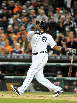 Tigers' Justin Upton hits a pop up single in the first inning.