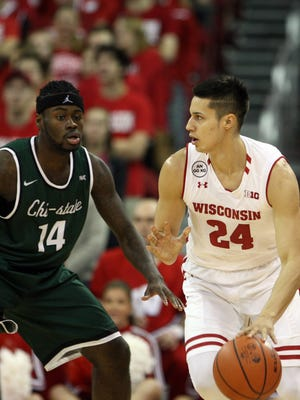 Badgers guard Bronson Koenig dribbles the ball as Chicago State guard Fred Sims Jr. defends him in the first half of the Badgers' 69-51 victory Thursday night at the Kohl Center.