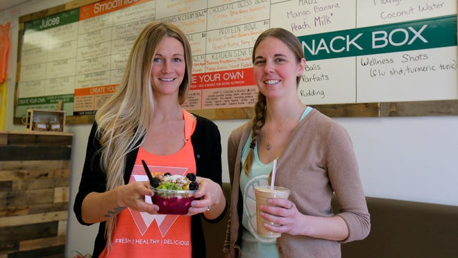 Kerry (left) and Alli O'Neill opened Kali-O's Juice Box earlier this month.