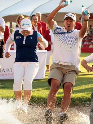 Inbee Park jumps into Poppie's Pond with her fiancé/coach Gi Hyeob Nam after winning the LPGA's 2013 Kraft Nabisco Championship.