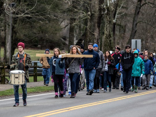The cross is carried from St. Edward to Denison University