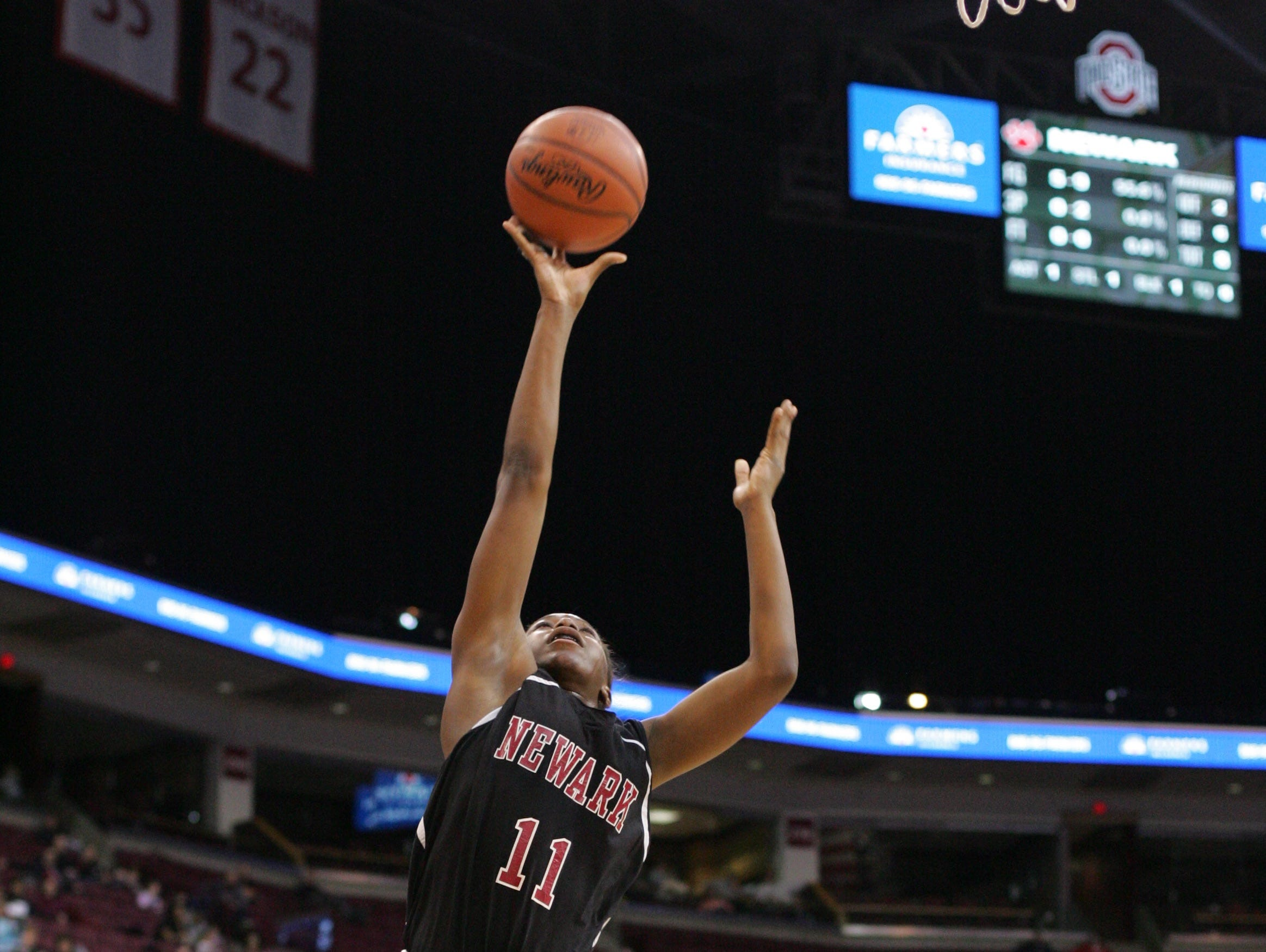 Newark senior Kym Royster drives to the net during the Division I state semifinal loss to Lakota West 53-50.